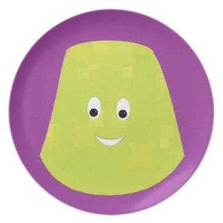 Smiling green gumdrop character plates