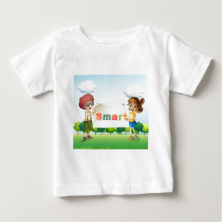 Smiling kids holding a signboard shirt