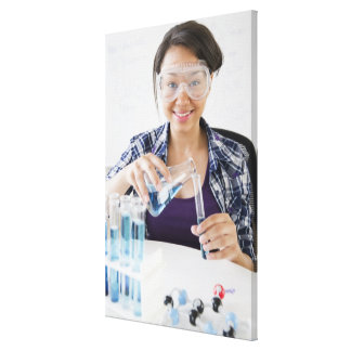 Smiling mixed race teenage girl conducting gallery wrap canvas