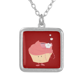 Smiling pink cupcake with flowered branch topping pendant