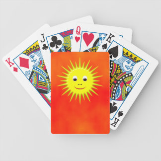 Smiling Sun with orange sky playing cards