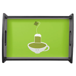 Smiling tea cup of green tea serving tray