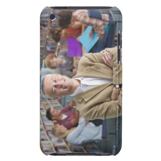 Smiling teacher standing in school library with barely there iPod case