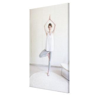 Smiling woman doing yoga canvas print