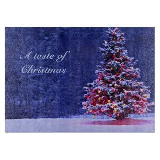 Snow Covered Christmas Tree on a Serene Night Cutting Board