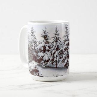 Snow covered fir trees mug