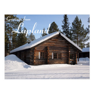 Snow-covered log cabin in Lapland text postcard