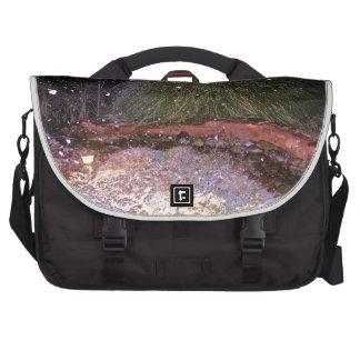 snow falling laptop commuter bag