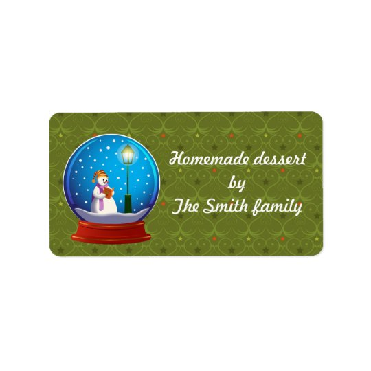 Snow globe with snow man singing. label