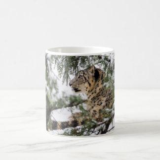 Snow Leopard Under Snowy Bush Coffee Mug