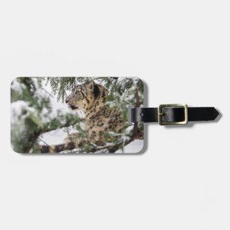 Snow Leopard Under Snowy Bush Luggage Tag