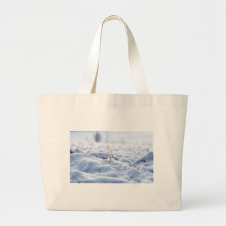 Snow on a meadow in winter macro large tote bag
