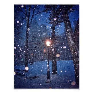 Snow Swirling Around A Streetlamp Photograph