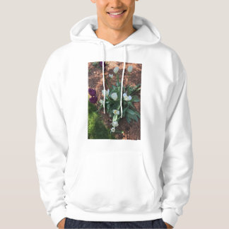 Snow white tulip type flowers in a garden hoodie