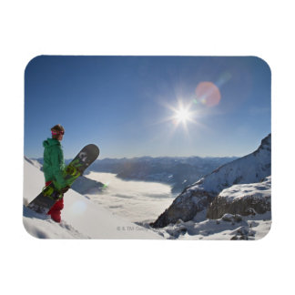 Snowboarder looking from mountain top magnet