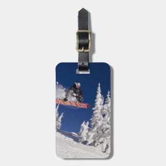 Snowboarding action at Whitefish Mountain Resort Luggage Tag
