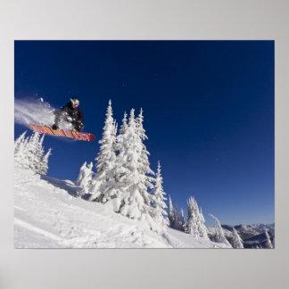 Snowboarding action at Whitefish Mountain Resort Poster