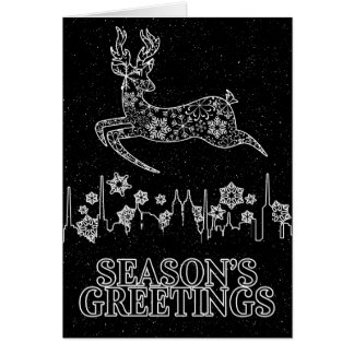 Snowflake Reindeer Leaping over Skyline Christmas Card