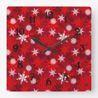 Snowflakes on red background square wall clock