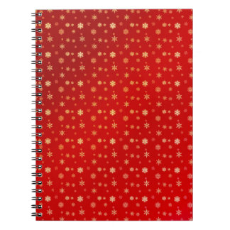 Snowflakes on red spiral notebook