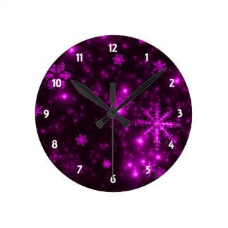 Snowflakes with Purple Background Round Clocks