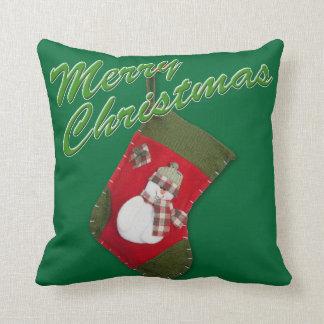 Snowman on Christmas Stocking Over Green Cushion