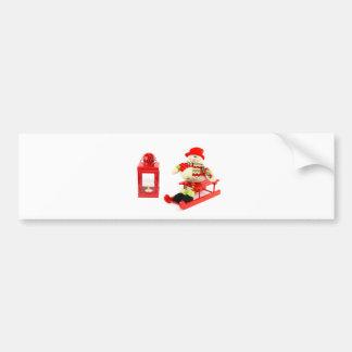Snowman on sleigh with red lantern bumper sticker