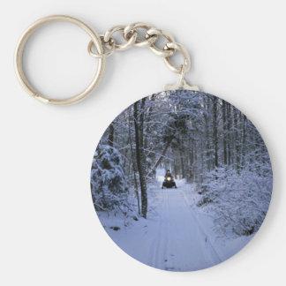 Snowmobiling after fresh snowfall Winter Key Ring