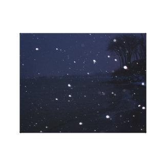 Snowy beach scene at dusk canvas print