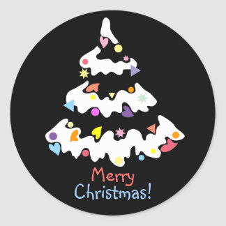 snowy decorated Christmas tree Round Sticker