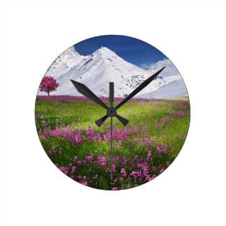 snowy mountains round clock