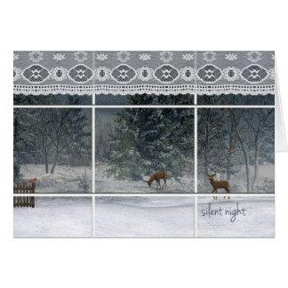 snowy night trees and deer looking through window greeting card