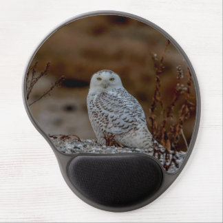 Snowy owl sitting on a rock gel mouse pad