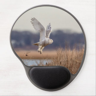 Snowy owl taking off gel mouse pad