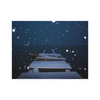 snowy pier at dusk canvas print