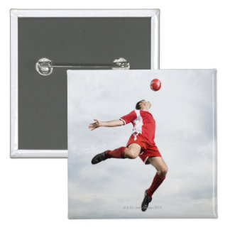 Soccer player and soccer ball in mid-air 15 cm square badge