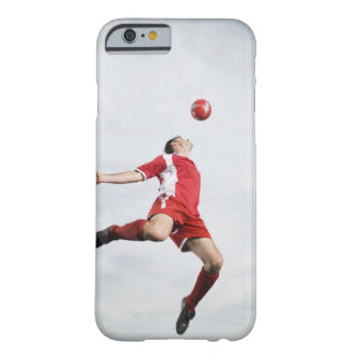 Soccer player and soccer ball in mid-air barely there iPhone 6 case