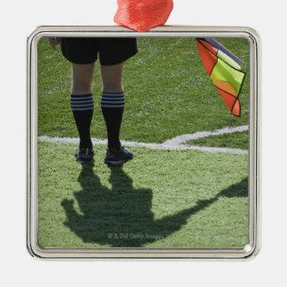Soccer referee holding flag. metal ornament