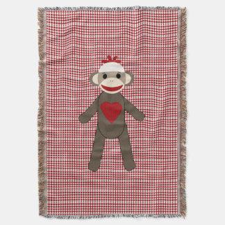 sock monkey woven blanket on red pattern