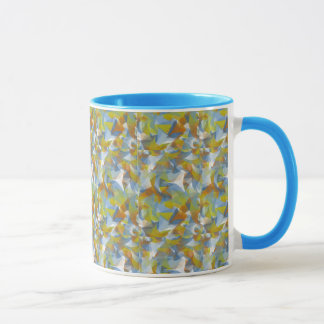 Soft blues/greens/orange swirling shapes on mug