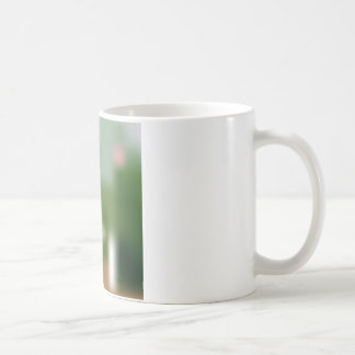 Soft pink bouquet of tulips on blurred coffee mug