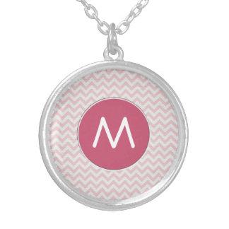 Soft pink zigzag pattern round pendant necklace