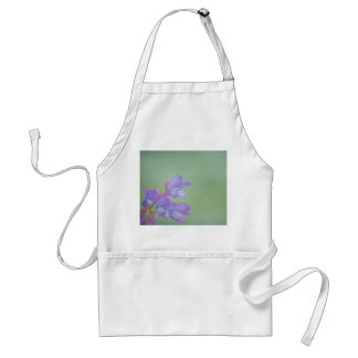 Soft Purple Wild Flowers with a Green Background Aprons