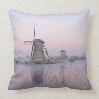 Soft sunrise light in winter over windmills cushion
