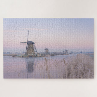 Soft sunrise light in winter over windmills jigsaw puzzle