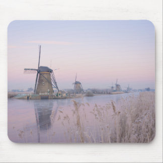 Soft sunrise light in winter over windmills mouse pad