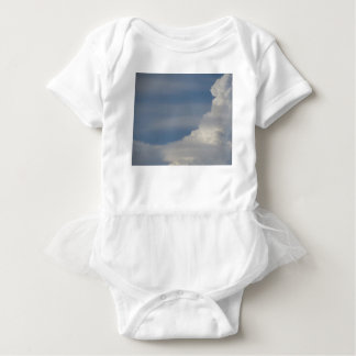 Soft white clouds against blue sky background baby bodysuit
