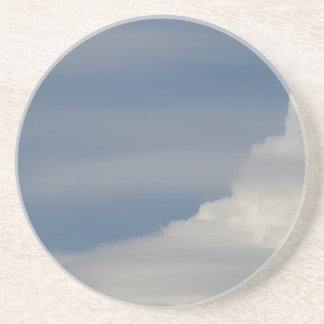 Soft white clouds against blue sky background coaster