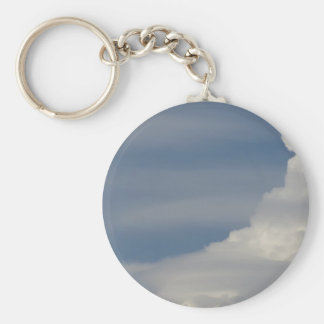 Soft white clouds against blue sky background key ring
