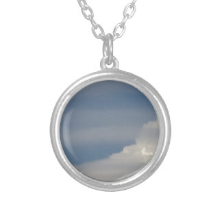 Soft white clouds against blue sky background silver plated necklace